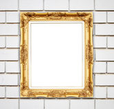 Blank golden frame on brick stone wall Royalty Free Stock Images