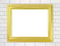 Blank golden frame on brick stone wall background Royalty Free Stock Image