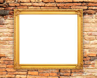 Blank golden frame on brick stone wall Royalty Free Stock Photos