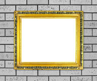 Blank golden frame on brick stone wall Stock Photo
