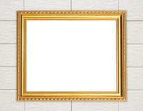 Blank golden frame on brick stone wall Royalty Free Stock Photo