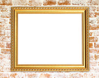 Blank golden frame on brick stone wall Stock Photography