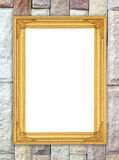 Blank golden frame on brick stone wall Royalty Free Stock Photography