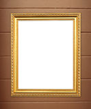Blank golden frame on cement wall Royalty Free Stock Images