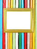 Blank golden frame on colorful bamboo wall Stock Images