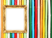 Blank golden frame on colorful bamboo wall Royalty Free Stock Images