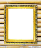 Blank golden frame on colorful bamboo wall Stock Image