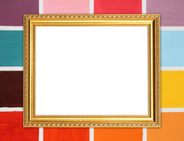 Blank golden frame on colorful wood wall Royalty Free Stock Photo