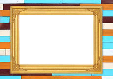 Blank golden frame on colorful wood wall Stock Image