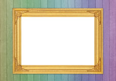 Blank golden frame on colorful wood wall Royalty Free Stock Image