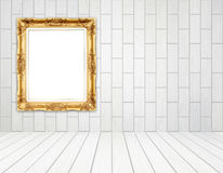 Blank golden frame in room with white wood wall (block style) an Stock Photo