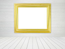 Blank golden frame in room with white wood wall and wood floor Stock Photos