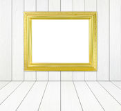 Blank golden frame in room with white wood wall and wood floor Stock Image