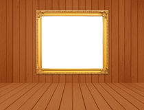 Blank golden frame in room with white wood wall and wood floor Royalty Free Stock Image