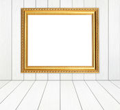 Blank golden frame in room with white wood wall and wood floor Royalty Free Stock Photos