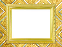 Blank golden frame on Thai style buddha wall Royalty Free Stock Image