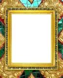 Blank golden frame on Thai style buddha wall Stock Photos