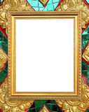 Blank golden frame on Thai style buddha wall Royalty Free Stock Photography