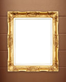Blank golden frame on whtie cement wall Royalty Free Stock Images