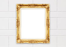 Blank golden frame on whtie cement wall Stock Image