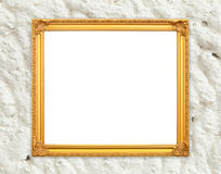 Blank golden frame on whtie cement wall Stock Photo