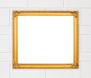 Blank golden frame on whtie cement wall Royalty Free Stock Photo