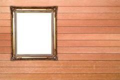 Blank golden frame on wood wall Stock Photos