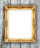 Blank golden frame on wood wall Royalty Free Stock Photos