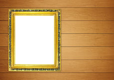 Blank golden frame on wood wall Royalty Free Stock Photography