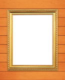 Blank golden frame on wood wall Stock Images