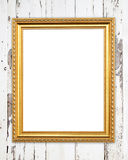 Blank golden frame on wood wall Stock Photography