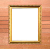 Blank golden frame on wood wall Royalty Free Stock Image