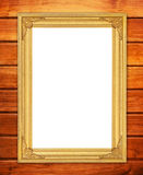 Blank golden frame on wood wall Stock Image