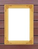 Blank golden frame on wood wall Stock Photos