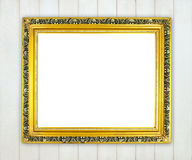 Blank golden frame on wood wall Royalty Free Stock Images