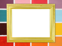Blank golden frame on wood wall background Stock Photos