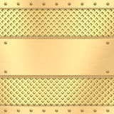 Blank golden plate on grid background with rivets Royalty Free Stock Photo