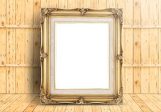 Blank golden Vintage frame on wood floor and plank wooden wall,T Stock Photography