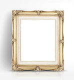 Blank golden vintage photo frame lean at wall in glossy white st Royalty Free Stock Images