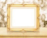 Blank golden vintage photo frame with sparkling gold bokeh wall Royalty Free Stock Photo