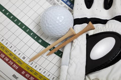 Blank Golf Scorecard. A blank golf scorecard with golf glove, tees and a golf ball.  Sports, golf concept Stock Photography