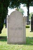 Blank gravestone. In a graveyard stock photos