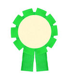Blank green award winning ribbon rosette isolated on white backg Royalty Free Stock Photo