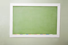 Blank green blackboard and chalk Royalty Free Stock Photo