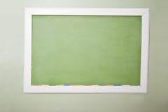 Blank green blackboard and chalk Royalty Free Stock Photo