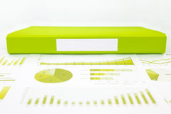 Blank green folder with analytic graph and educational reports Royalty Free Stock Image