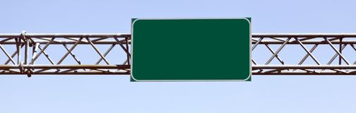 Blank green Interstate Sign Attached to Overhead Steel Support. stock photography