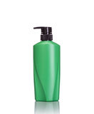 Blank green pump plastic bottle used for shampoo or soap. Studio Royalty Free Stock Photo