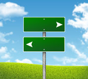 Blank green road signs. Hills, clouds in Royalty Free Stock Photography