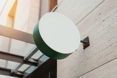 Blank round store signboard. Empty shop lightbox on the wall. Blank green round store signboard Mockup. Empty circular illuminated shop lightbox template mounted stock image